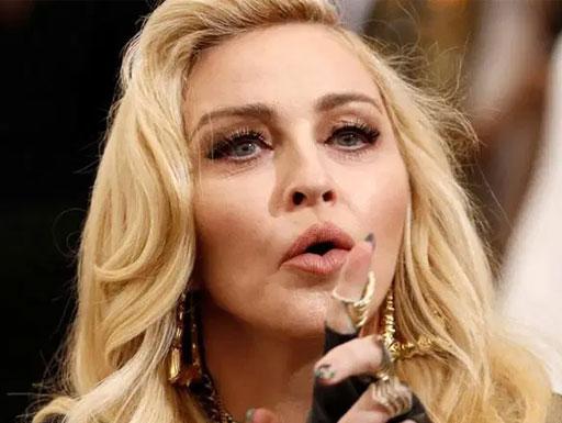 Madonna explode com seguidora sobre controle de armas nos EUA